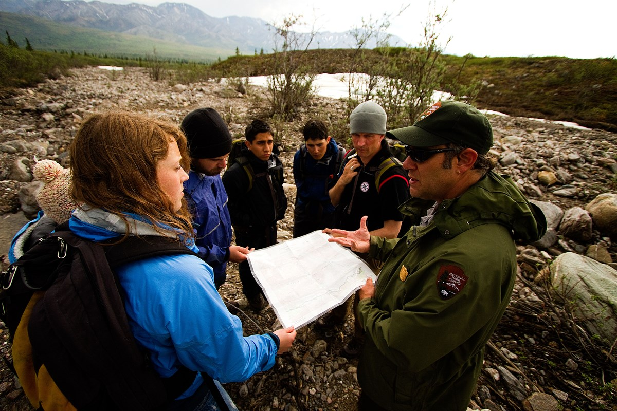Ranger talking with group of hikers