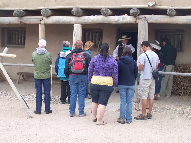 Park Interpreter with tour group at Bent's Old Fort National Historic Site