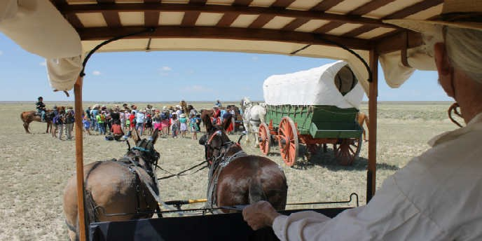 Caravan from Dearborn with people, two wagons, mules and horses