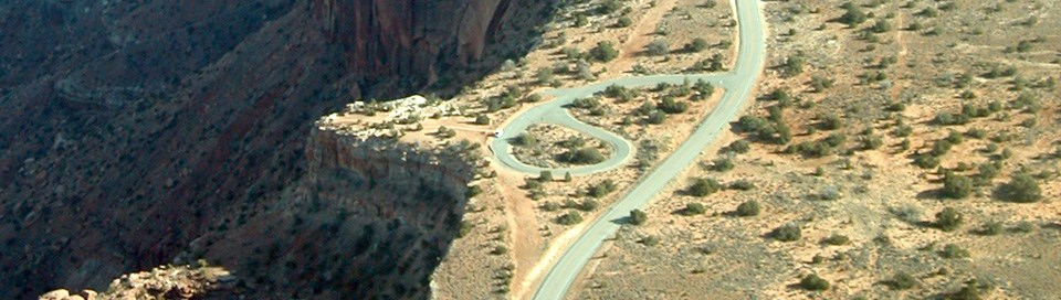 An aerial view of a road near a viewpoint