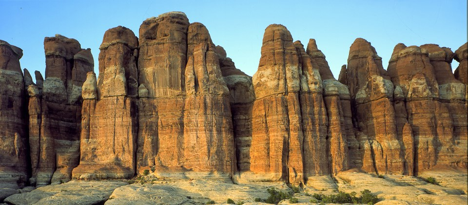 tall spires of sandstone with bands of white and red rock