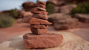 Stacked rocks form a cairn along the trail in Canyonlands National Park.