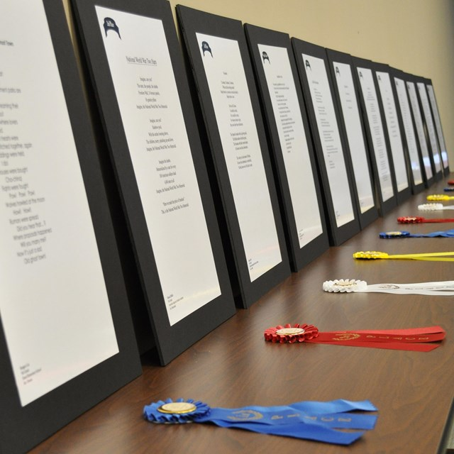 Ribbons and poems are displayed for student recognition.
