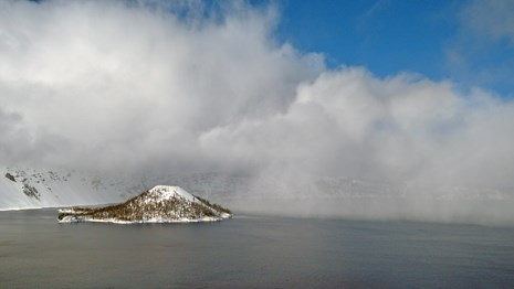Clouds move across the surface of Crater Lake.