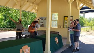 The Boston Mill Train Depot has become an outdoor visitor center where staff are helping visitors