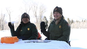 Rangers Behind Snow Desk