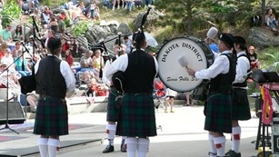 A group of bagpipers perform at Mount Rushmore.