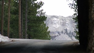 Mount Rushmore viewed through a tunnel on the nearby Iron Mountain Road.