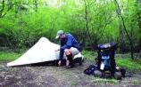 A backcountry camper prepares his campsite in Shenandoah National Park.