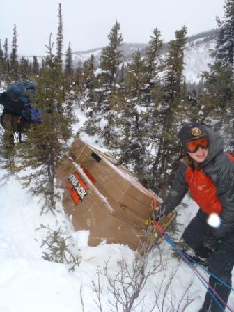 Knack box load stuck in trees and snow