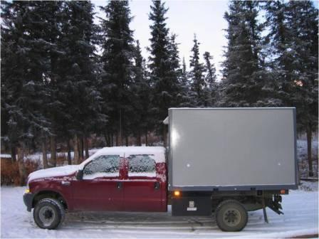 kennel's truck with dog box on it