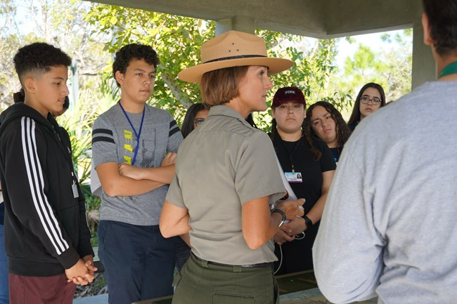 A park ranger talking to a group of students