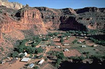 aerial view looking down onto fields and houses in Supai Village.