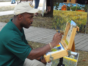 Artist-in-Residence Steven S. Walker at work on a landscape painting.