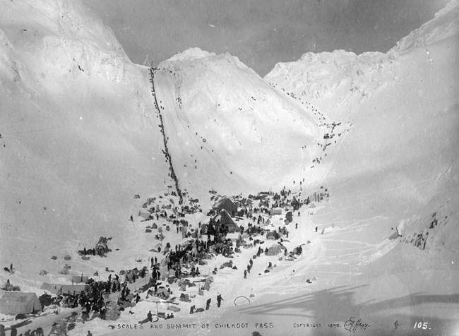 Historic photo of people at the scales and climbing the pass