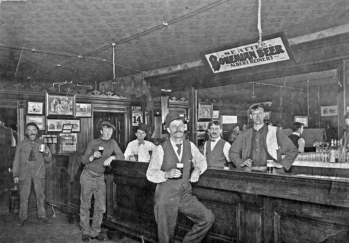six men stand in a bar