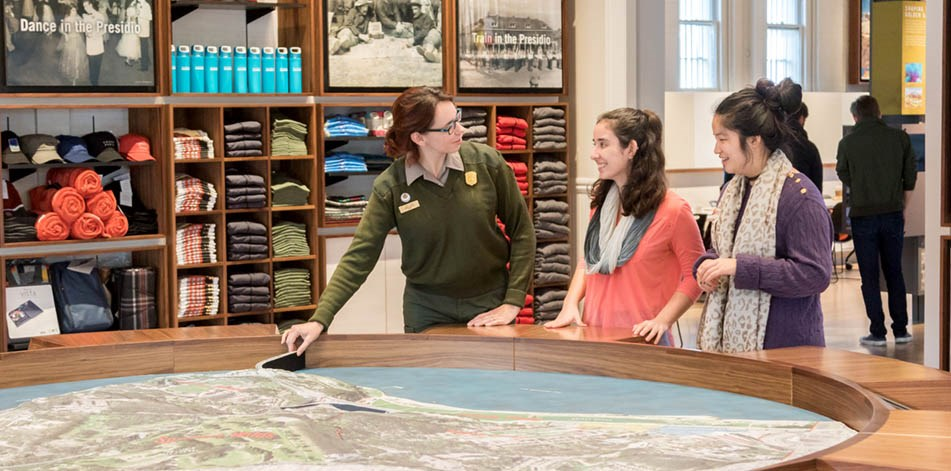 Park ranger pointing out location on map for visitors