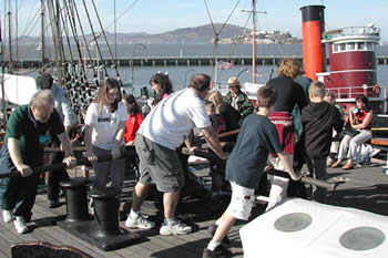 Turning the capstan on Balcluth's foredeck.