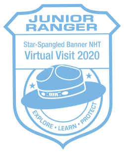 Blue and white badge-shaped stamp for the Star-Spangled Banner Junior Ranger program