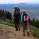 Two women hike up the Mt. Washburn trail.