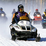Person riding a snowmobile.