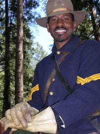 Posed shot of a park ranger dressed as a Buffalo Soldier