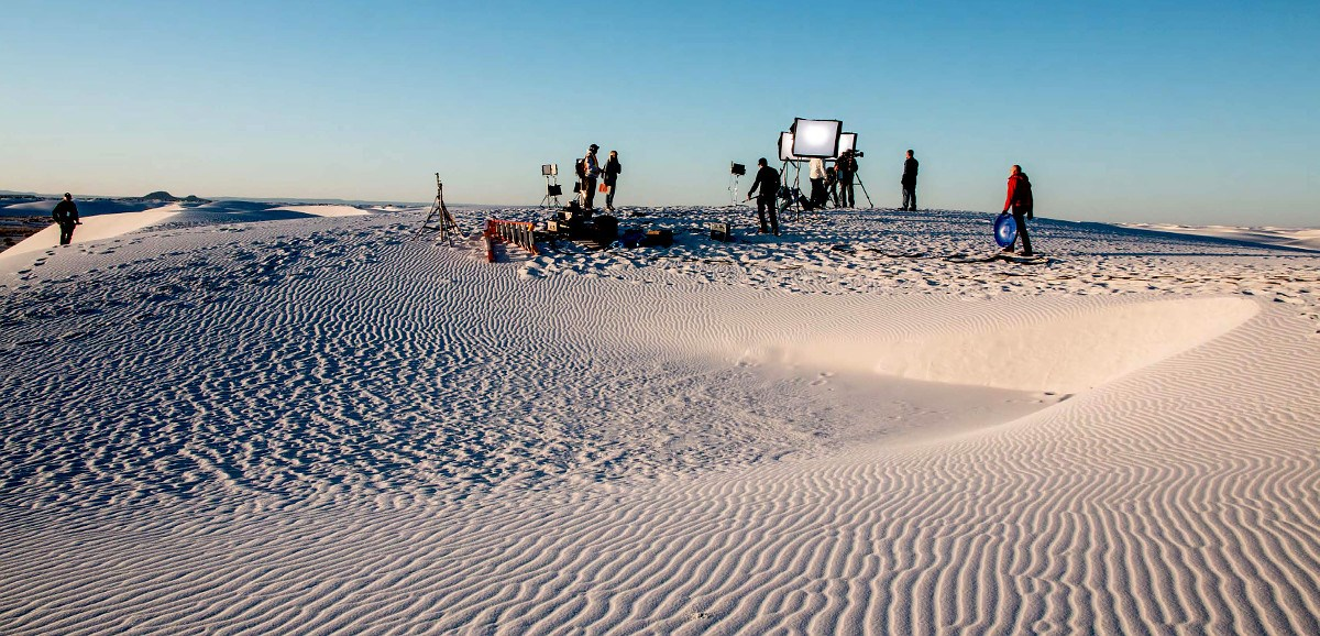 Film crew on white sand dunes