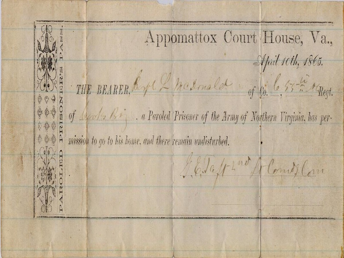 "paper stamped with text reading ""Appomattox Court House, VA April 10th, 1865. The BEARER, L. McDonald of company and regiment (text illegible) a paroled Prisoner of the Army of Northern Virginia, has permission to go to his home, and remain undisturbed."