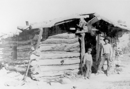 Turnbow and son at Wolfe Cabin