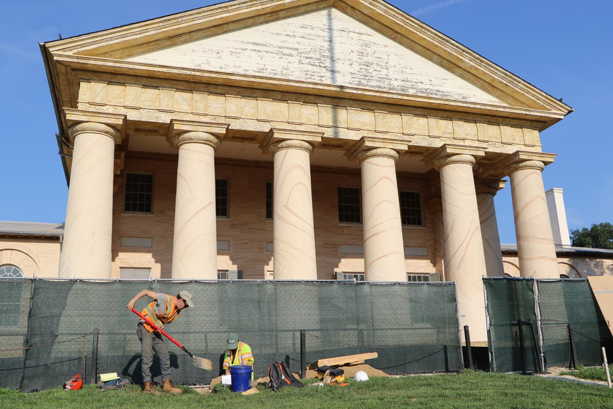 Archeologists dig in front of Arlington House.