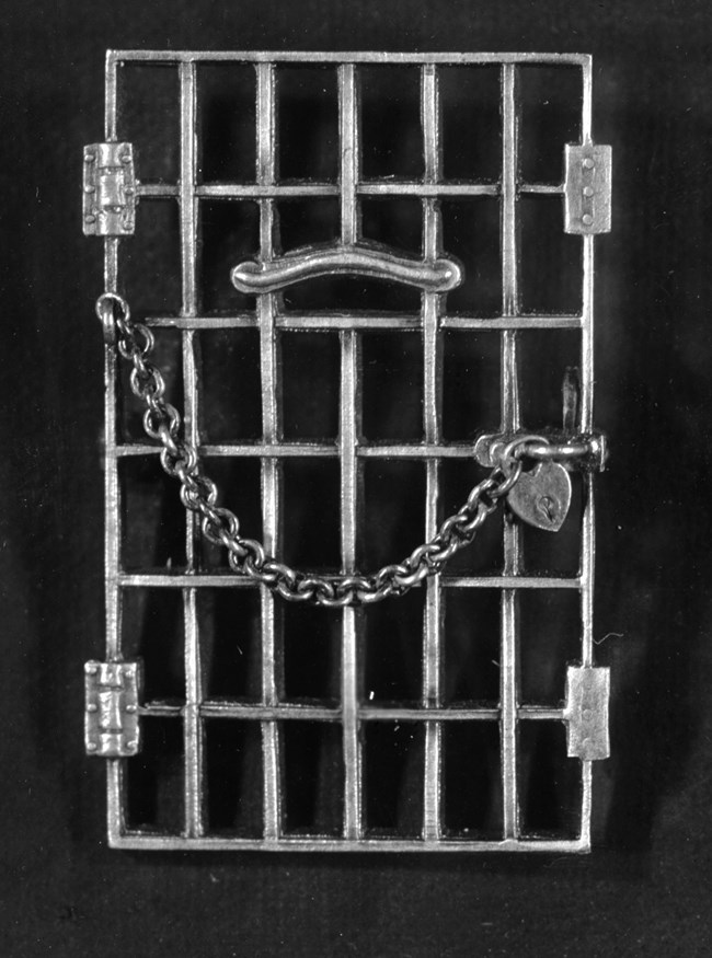 Pin of jail door with lock