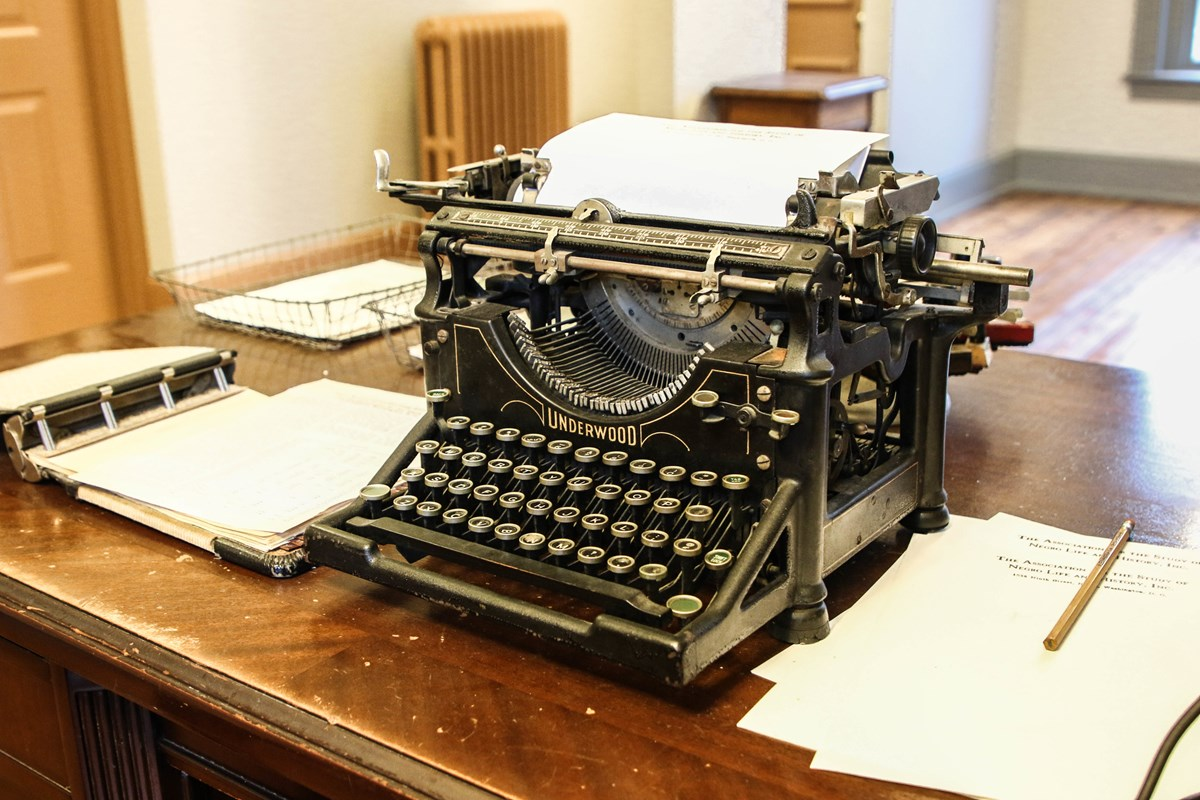 Typewriter and papers on a desk