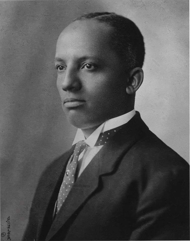 Black and white portrait of young Carter G Woodson
