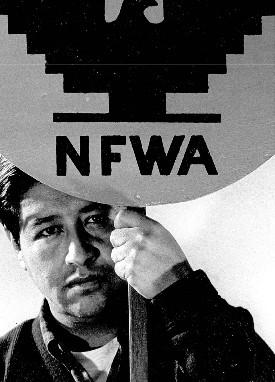 Historic image of Cesar Chavez carrying a picket sign