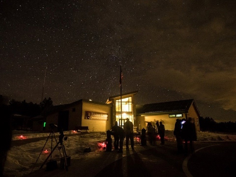 Star party outside a visitor center at night