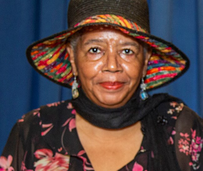 African American woman wearing a hat