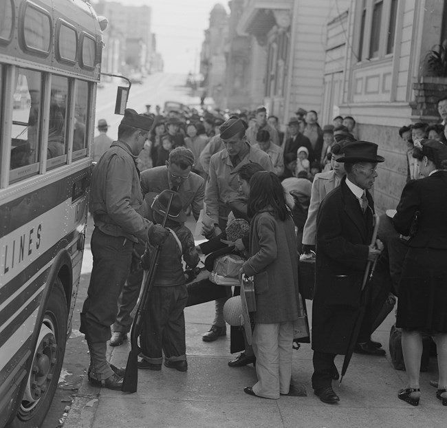 Japanese Americans being forced to leave San Francisco.