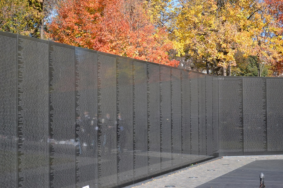 Black-colored memorial wall listing more than 50,000 names of soldiers