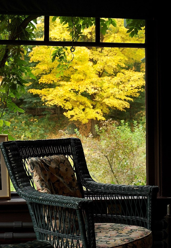 chair in interior patio with fall colors outside