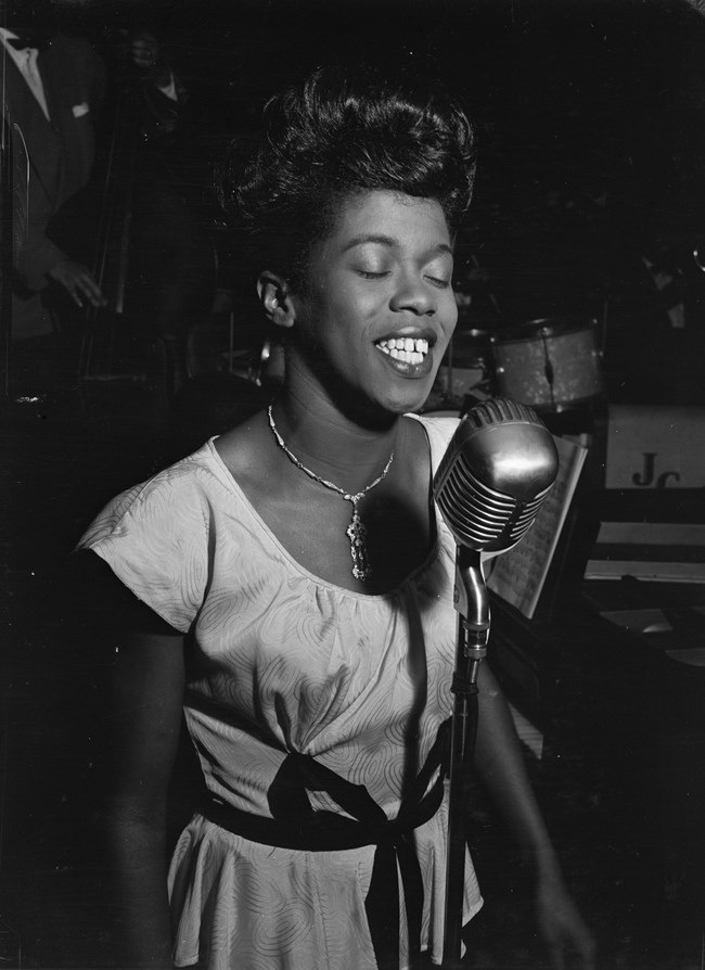 Photo of a woman singing. Library of Congress.