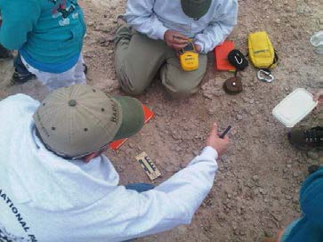 Paleontologists uncover a fossil tooth.