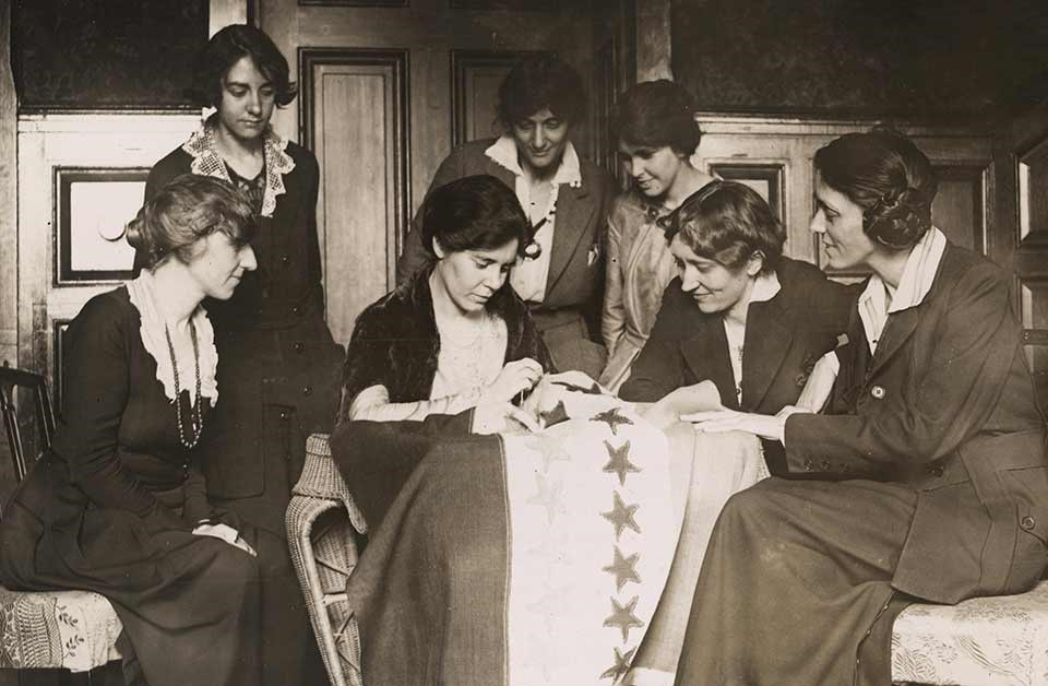 NWP activists watching Alice Paul Sew Star on Flag