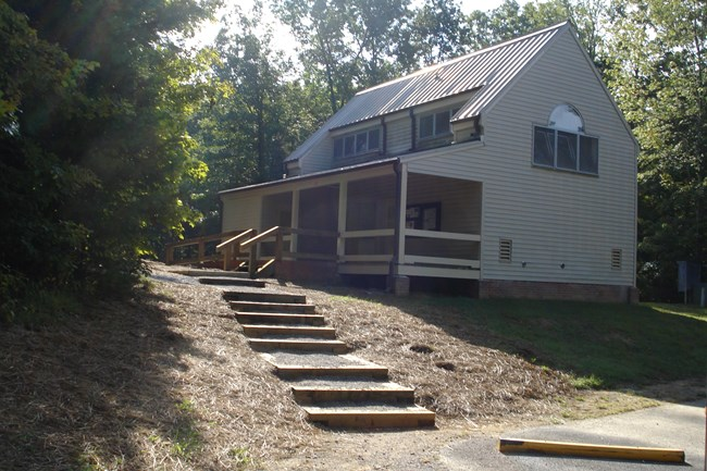 bath house in campground with newly mulched ground where work has been done on steps