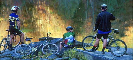 Mountain bikers rest along the banks of North White Oak Creek.