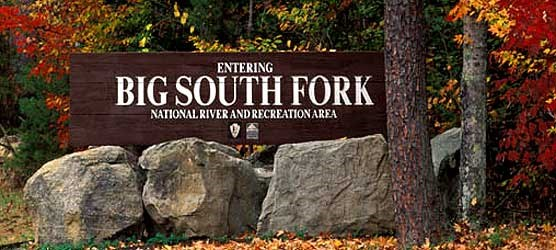 Big South Fork entrance sign with fall colors in background.