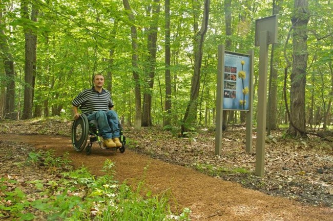 Visitor in wheelchair on Spicebush Trail