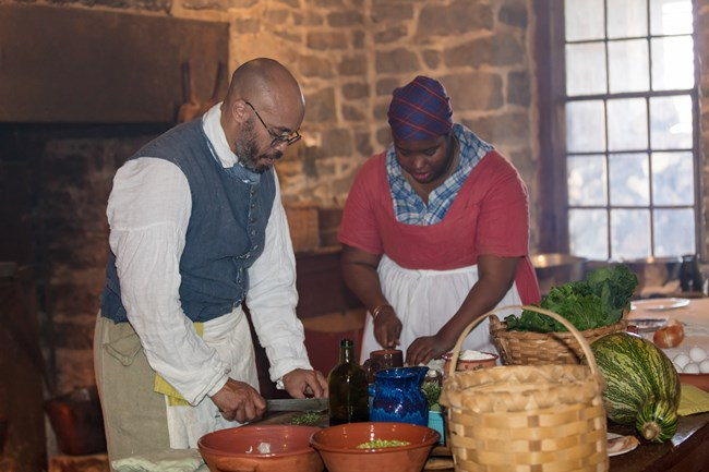 Jerome Bias and Cheyney McKinght portraying enslaved cooks at Belle Grove