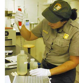 Biological Technician Candice La Russa performs test on water samples from the Chattahoochee River.