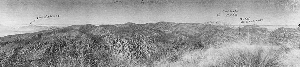 Black and white photo of a rocky mountain range