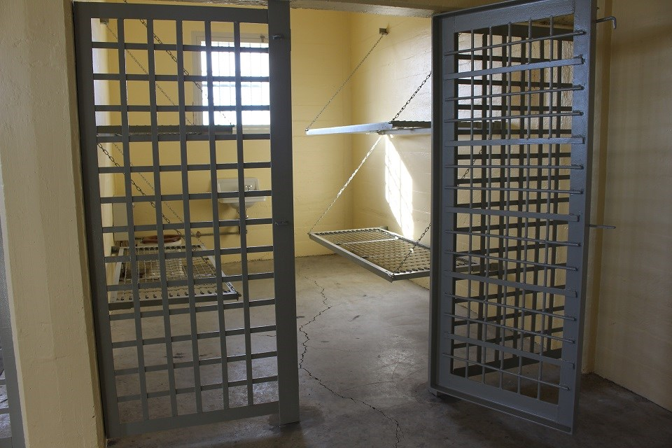 Empty jail cell with bunks